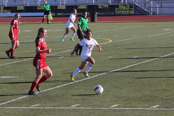 No. 7 Toby Martinez sprints towards the ball. Photo by Sarah Martinez