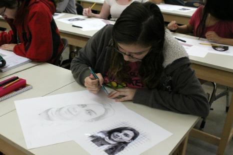 Students in Art I create self-portraits
