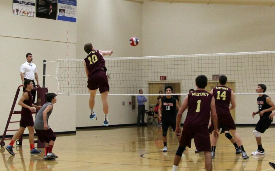 Outside+hitter+Andrew+Gruber+jumps+to+attempt+a+kill+during+the+first+set+against+Bella+Vista.+Photo+by+Rylea+Gillis.