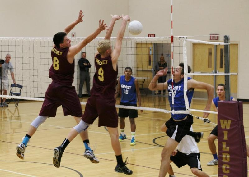 Will Bebinger and Matt Honberger make a block together in the first set against Grant.