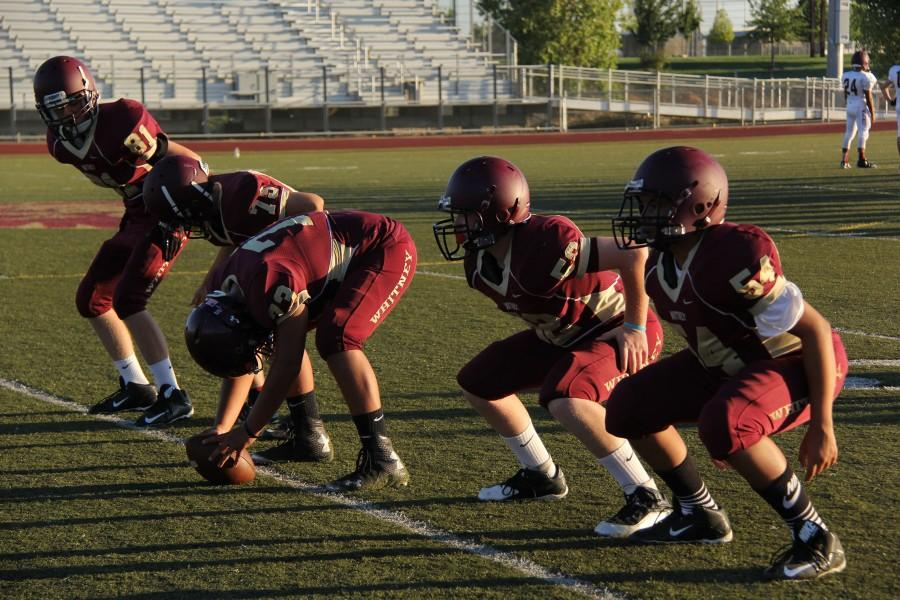 Maroon offense warms up before the game. Photo by Sierra Young