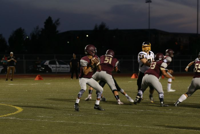 Hunter Rodriguez drops back to pass. Photo by Deanna Payan