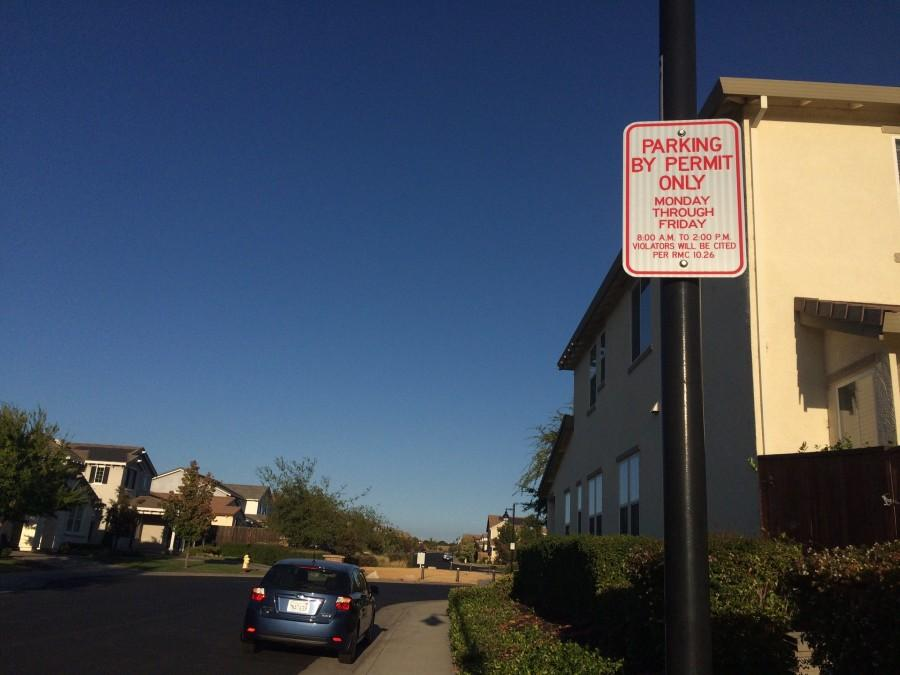 Parking signs are posted on every light post on Abilene Circle and Stageline Circle. Photo by Olivia Grahl