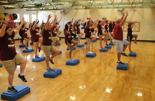 On Sept. 3, Mr. John Bosco leads sixth period step aerobics in a step routine. Photo by Olivia Grahl