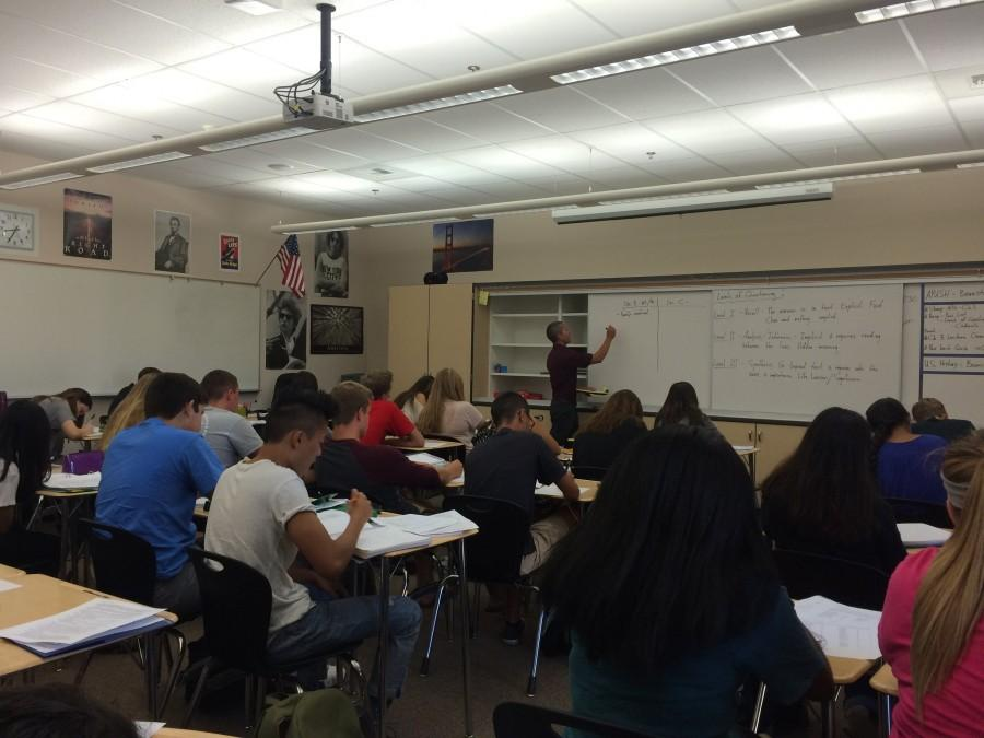 Mr. Tony Bannister lectures his first period AP U.S. History class about levels of questioning. Photo by Missie Caracut.