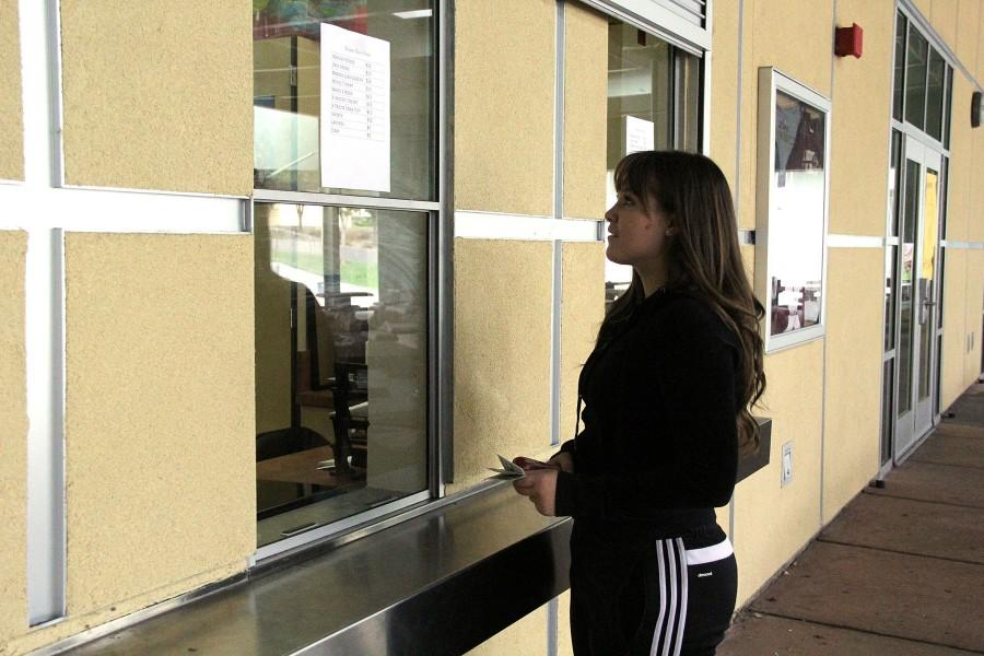 Bella Jacobs waits to buy a ticket at the student store. Photo illustration by Sierra Young