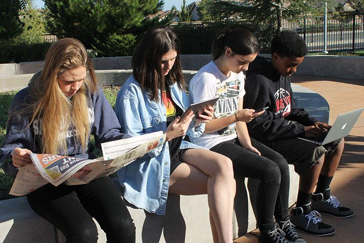 Photo+illustration+of+students+reading+the+news.+Photo+by+Olivia+Grahl