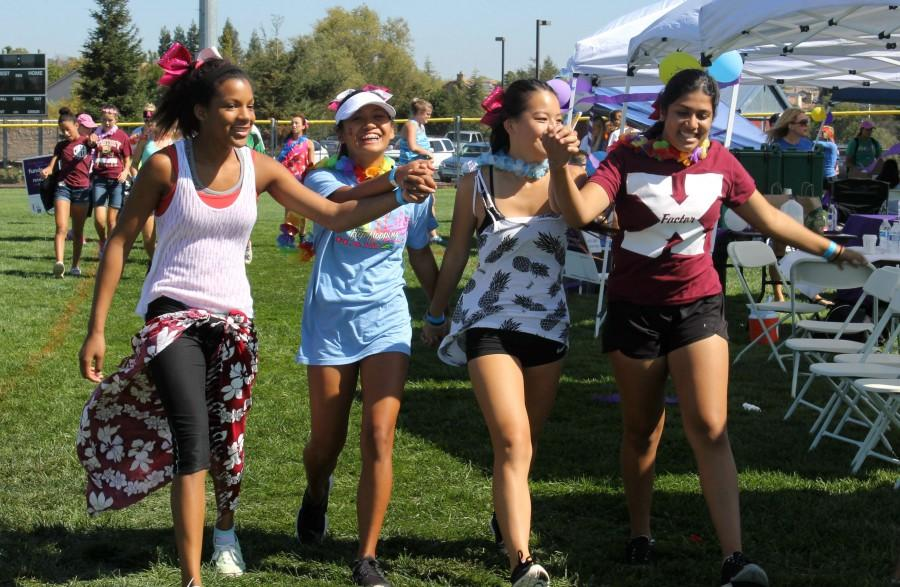 Freshman+cheerleaders+Ketura+Doyle+Phillips%2C+Nica+Perez%2C+Libi+Mortensen+and+Ishiqa+Sukkar+walk+the+Hawaiian-themed+lap+at+Relay+for+Life.+Photo+by+Rylea+Gillis.