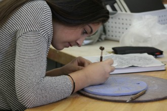 Students in Ceramics II create sgraffito tiles with famous inspiration
