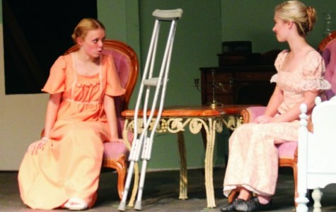 Isabelle Wheeler on stage as Harriet with  Sarah Goulette as Emma. Picture by Ona Igbinedion