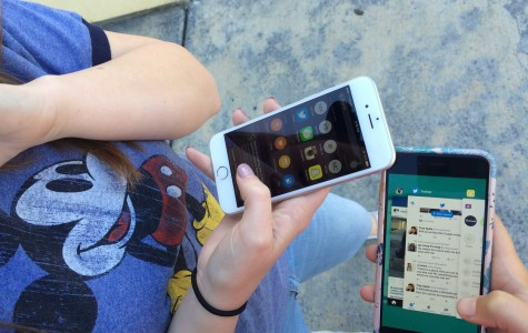 Lily Jones and Rylea Gillis look at the new features iOS 9 has to offer. Picture by Missie Caracut.
