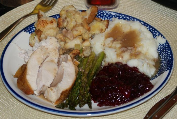 Multiple Thanksgiving foods are put on a plate. Photo by Daniel Sharrah
