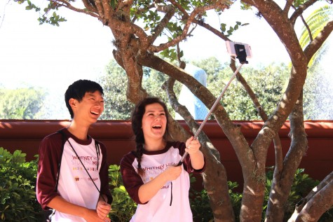 Olivia Grahl and Ben Kim take a selfie with their selfie stick. Photo by Sierra Young