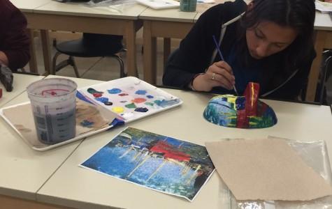 Art II students recreate paintings on 3D masks