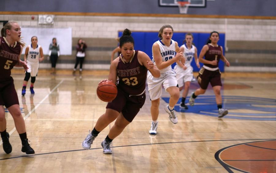 Kymaya Wallace evades Rocklin defenders to set up for a shot. Photo by Rylea Gillis