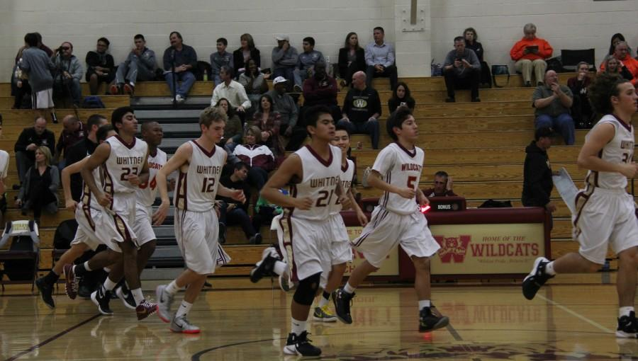 JV Wildcats running in at halftime. Photo by Zachary Hall
