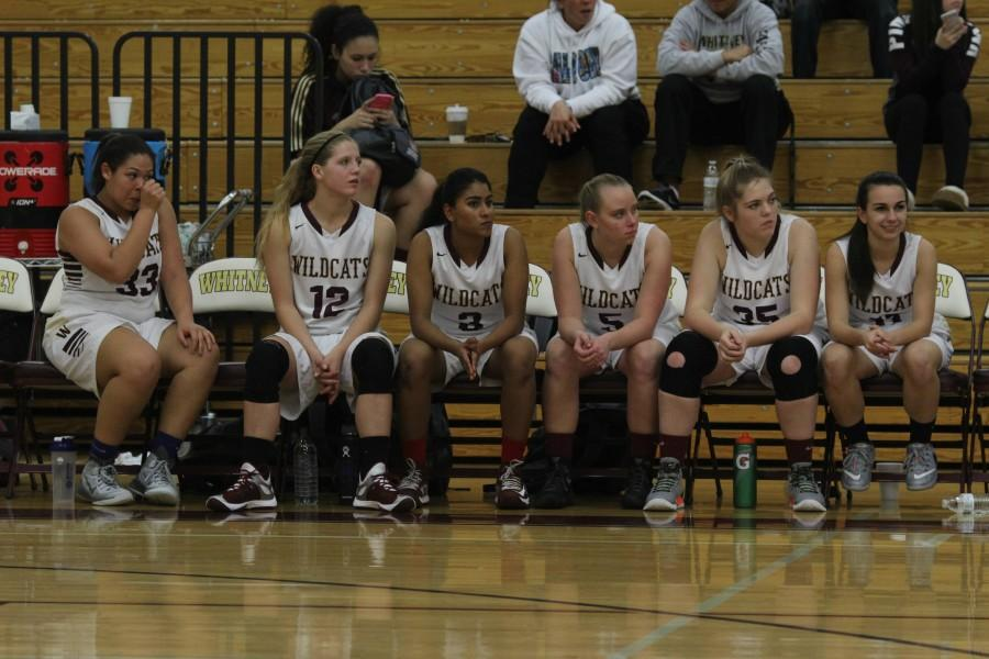Players watch their team from the sideline. Photo by Rylea Gillis.