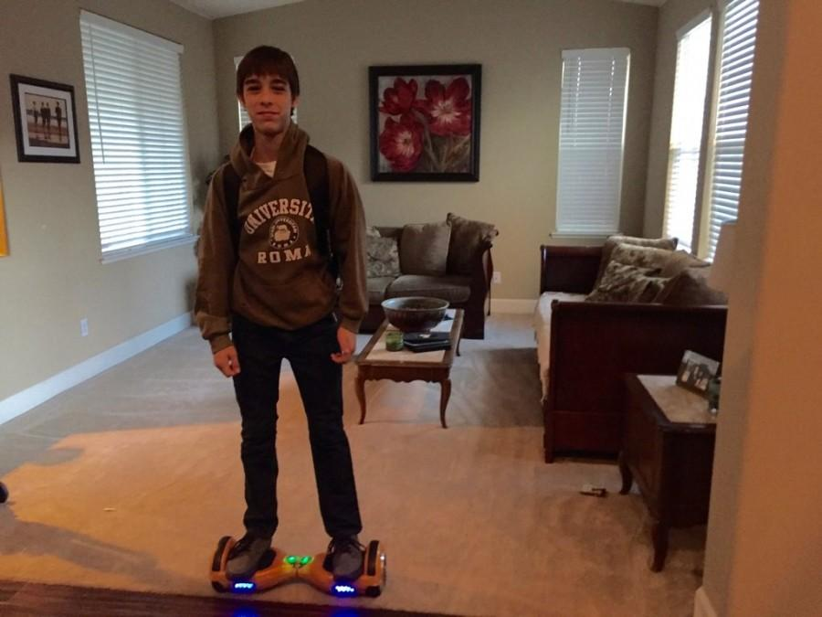 Cole Kachmar stands on his hoverboard that he received from Christmas. Photo by Joe Kachmar