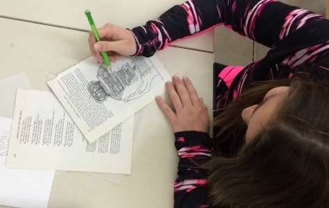 Art III students use vintage book pages, glass to create nightlights