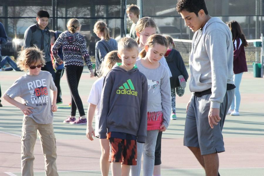 Jonathan Guerrero coaches kids through drills. Photo by Luke Wetzel