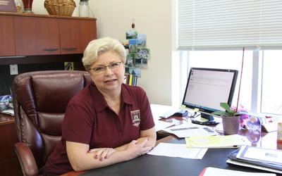 Principal Debra Hawkins sit at her desk Feb. 11. Photo by Sarah Martinez