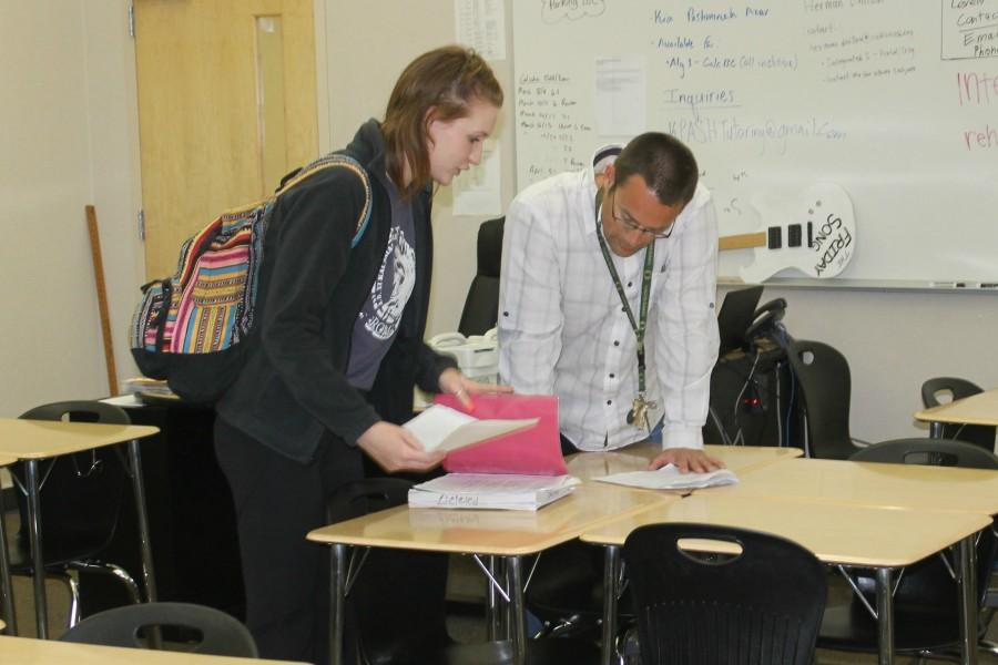 Mr. Joel Williams helps a student with her homework. Photo by Benjamin Kim