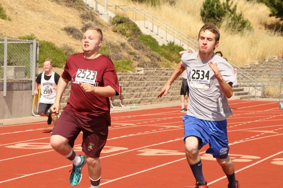 Kaleb Ross and Jackson Brewer race in the 100 meter dash. Photo by Rylea Gillis