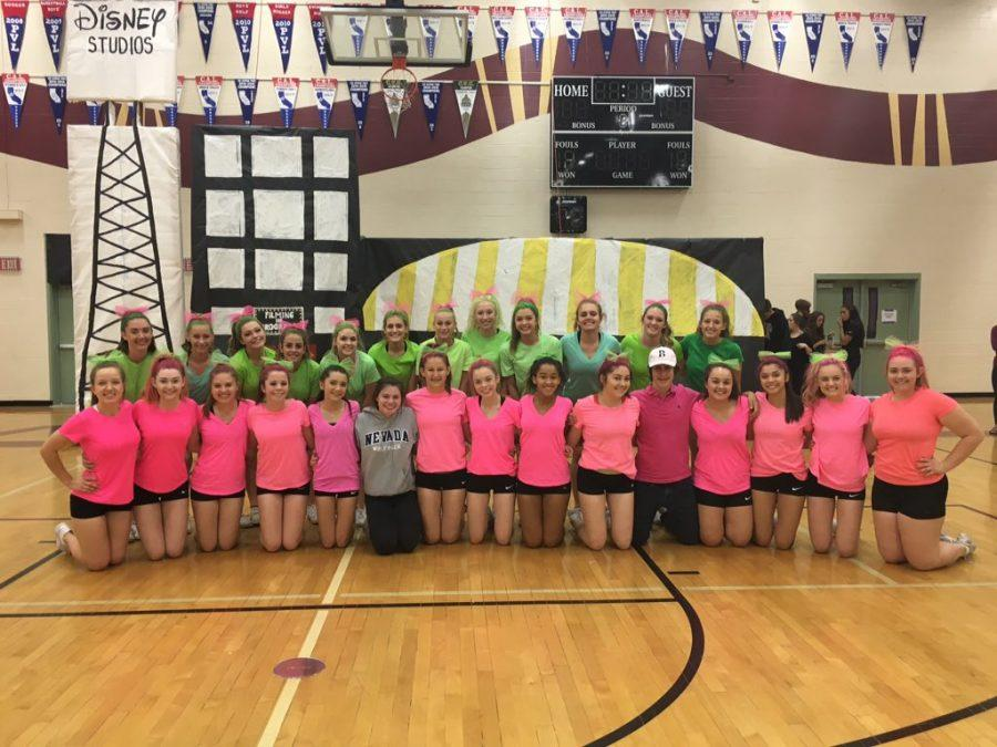 Noah Otto poses with the varsity cheer team after their performance at the end of the year rally. Photo by Mrs. Nicole Ferguson