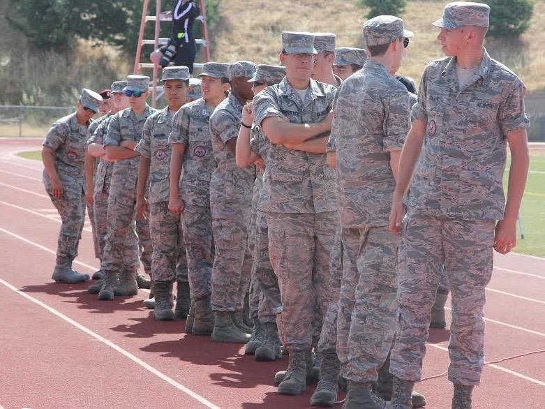 Photo by Avery Van der Linden. Students in ROTC line up on track during their drill meet