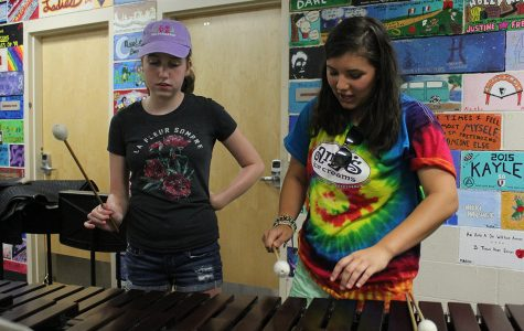 Julia Allwardt and Shelby Johnson plays xylophone. Photo by Maximo Esguerra