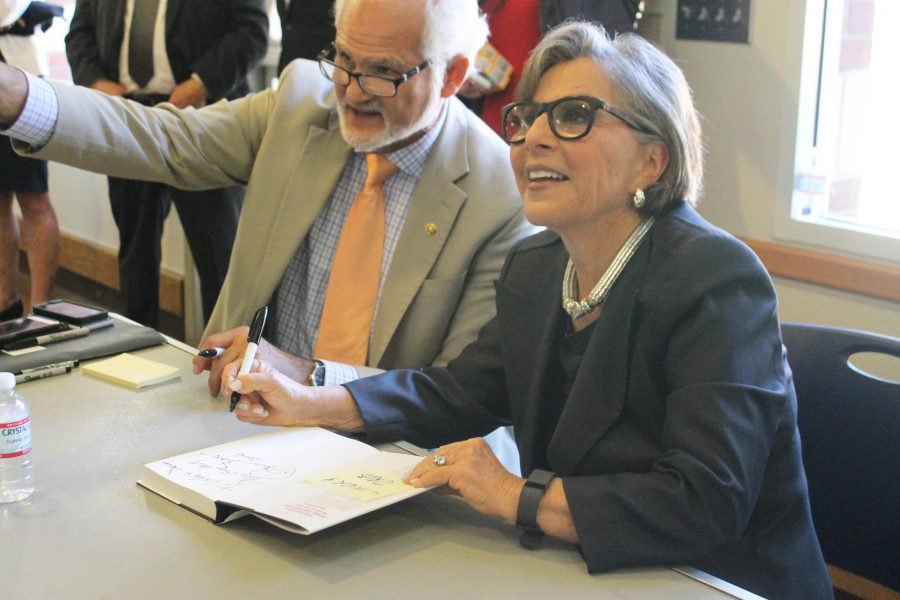 After she gives a speech, Senator Barbara Boxer signs fans copies of her book The Art of Tough. Photo by Rylea Gillis