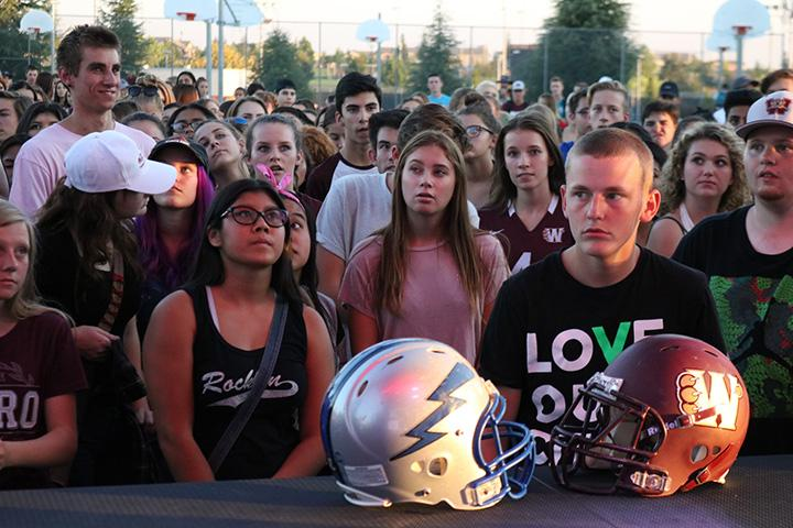 During Mr. Travis Mougette's speech, a crowd gathers in front of the stage at the first outdoor night rally. Photo by Emma Thomas