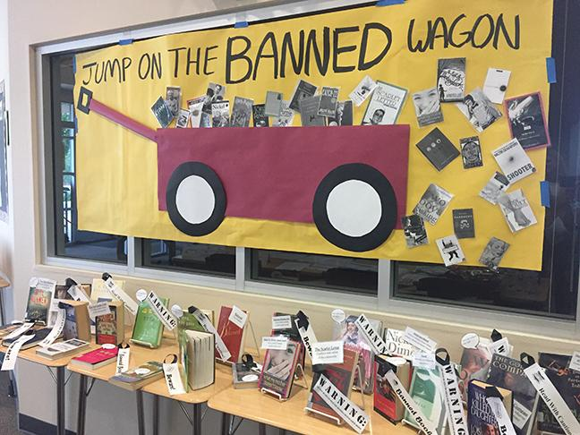 Mrs. Patty Golditch decorates the library for Banned Books Week. Photo by Emma Accacian