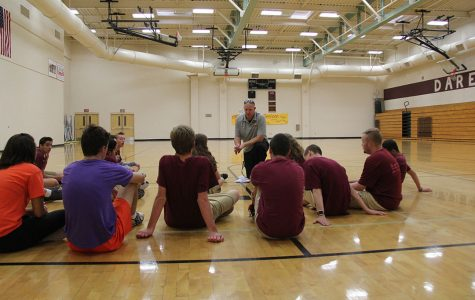 Coach Nicholas French explains the details of the Spooktacular to the athletes. Photo by Deanna Payan.