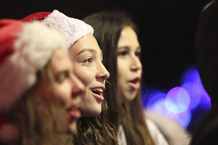 Madeline Cortez and other CSF members sing Christmas carols at families' door steps. Photo by Megan Anderson and Kaela Dandeneau