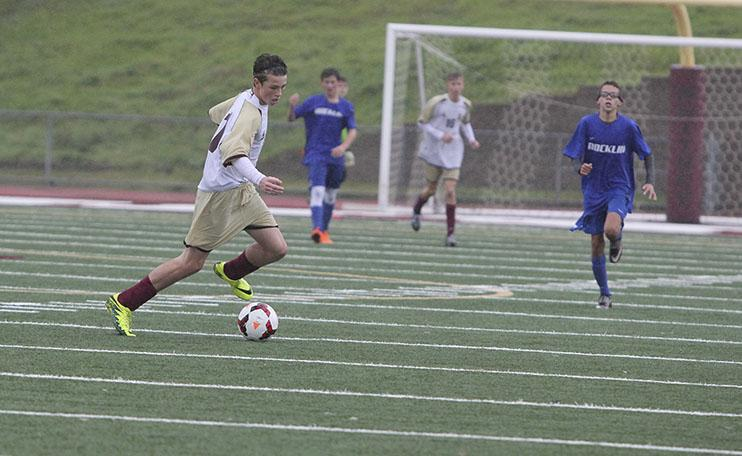 Anthony Baglietto dribbles the ball down the field. Photo by Lizzie Salvato.