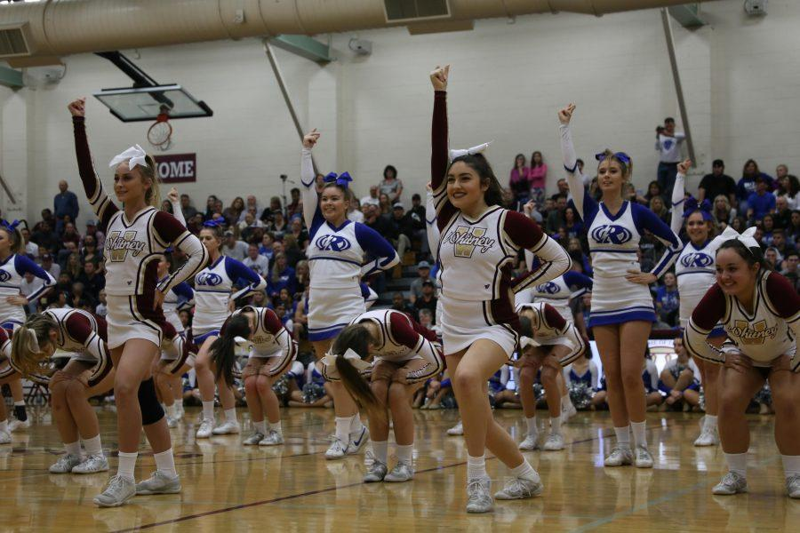 "Cheerleaders perform during halftime to Zara Larrson's ""Ain't my fault"" with Rocklin's varsity cheer team at the Quarry Classic men's varsity basketball game Dec. 13. Photo by Lizzie Salvato"