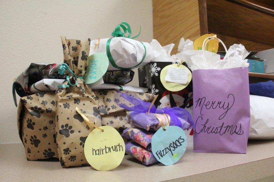 Gifts turned in by students for the Giving Tree being stored in the office until winter break. Photo by Morgan Hawkins