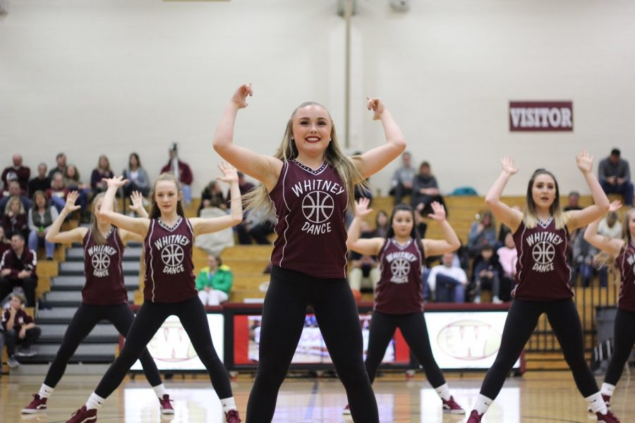 At the men's varsity basketball game against Roseville, Sydney Schreiner performs with the dance team at halftime. Photo by Rylea Gillis.