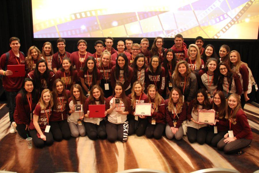 At last years STN convention in Atlanta, broadcast students pose for a photo at the end of the week with the awards that they won. Photo by Ben Barnholdt.
