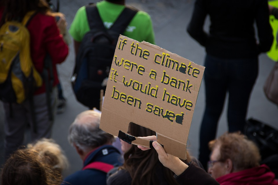 Photo depicting a poster at the People's Climate March in New York City. Photo by Nick Verlaan CC0 1.0