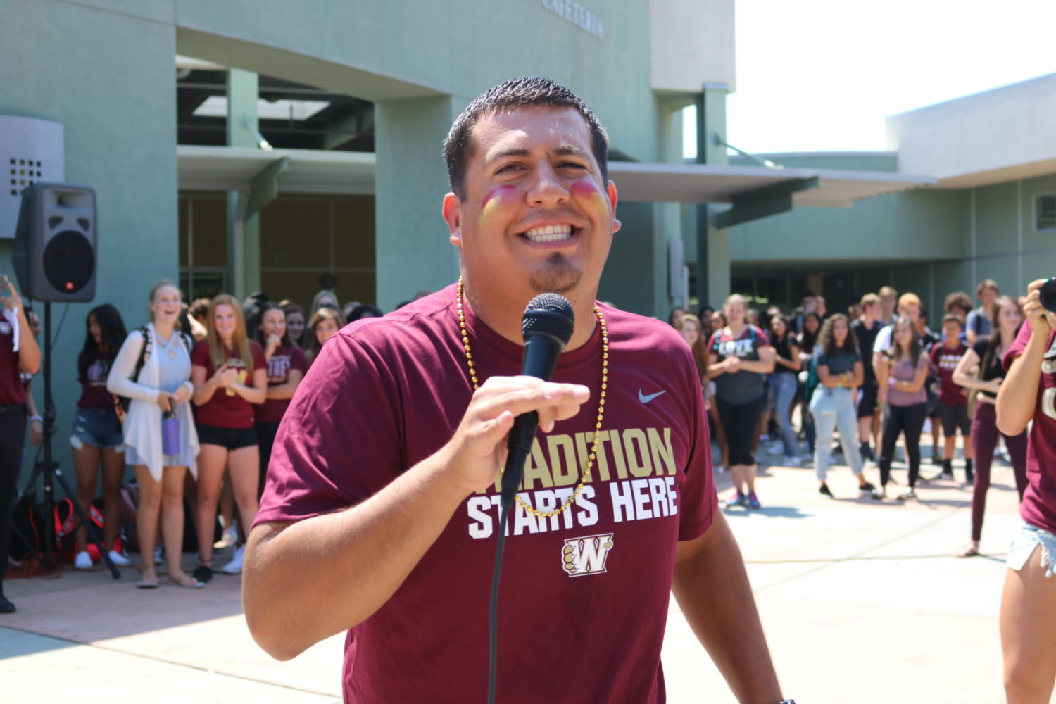 During the first Maroon Friday Lunch Time Activity, Mr. Jesse Armas sings  La Bamba. Photo by Lizzie Salvato.