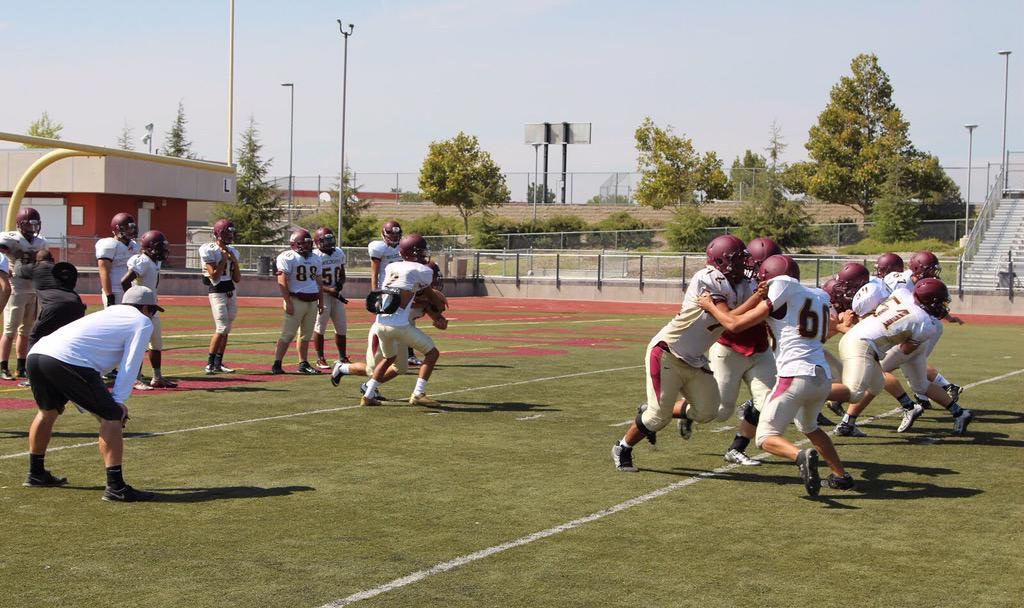 Mr. Paul Doherty coaches a varsity football practice. Whitney Update file photo.