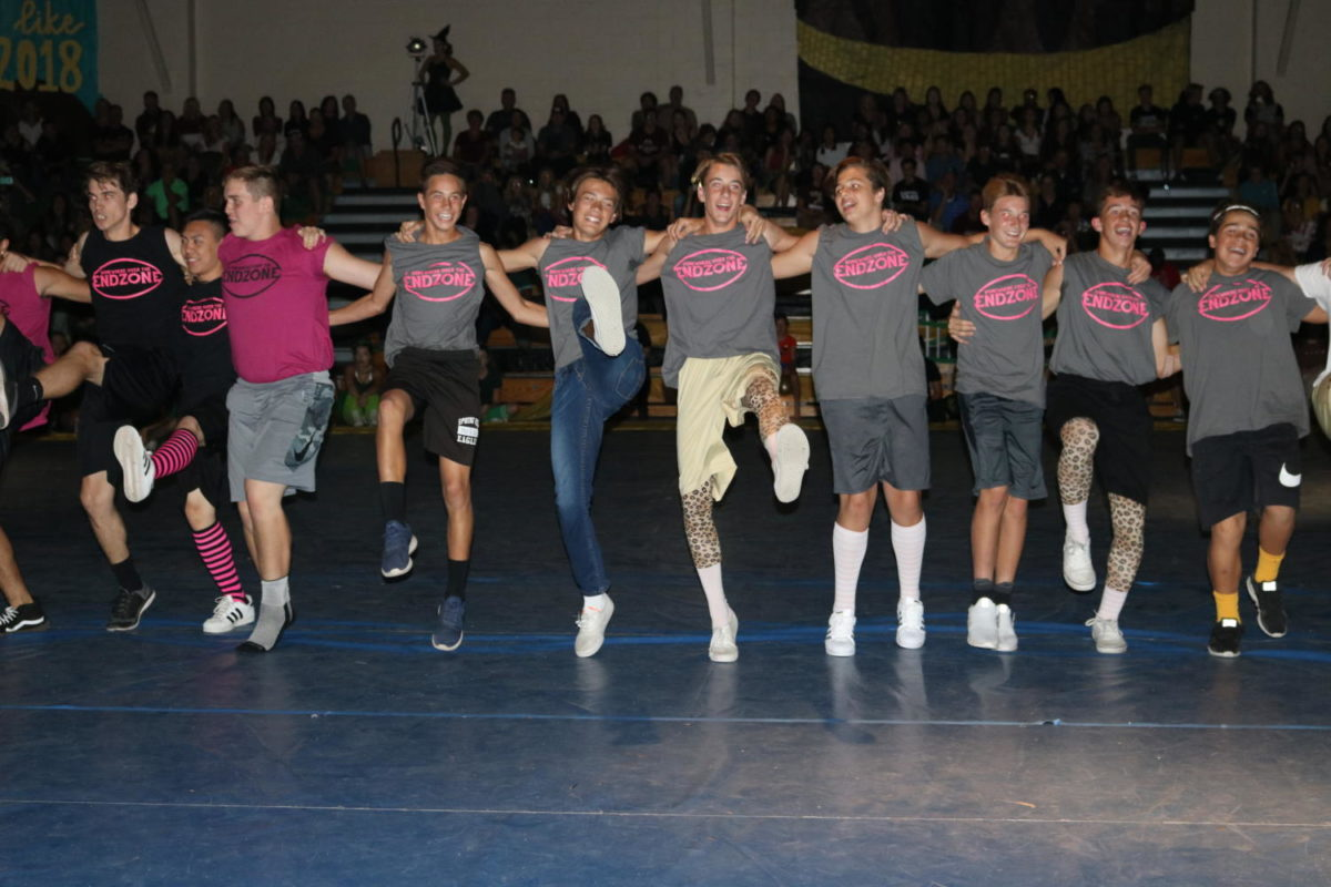 All powder puff cheerleaders from each class come together to perform.