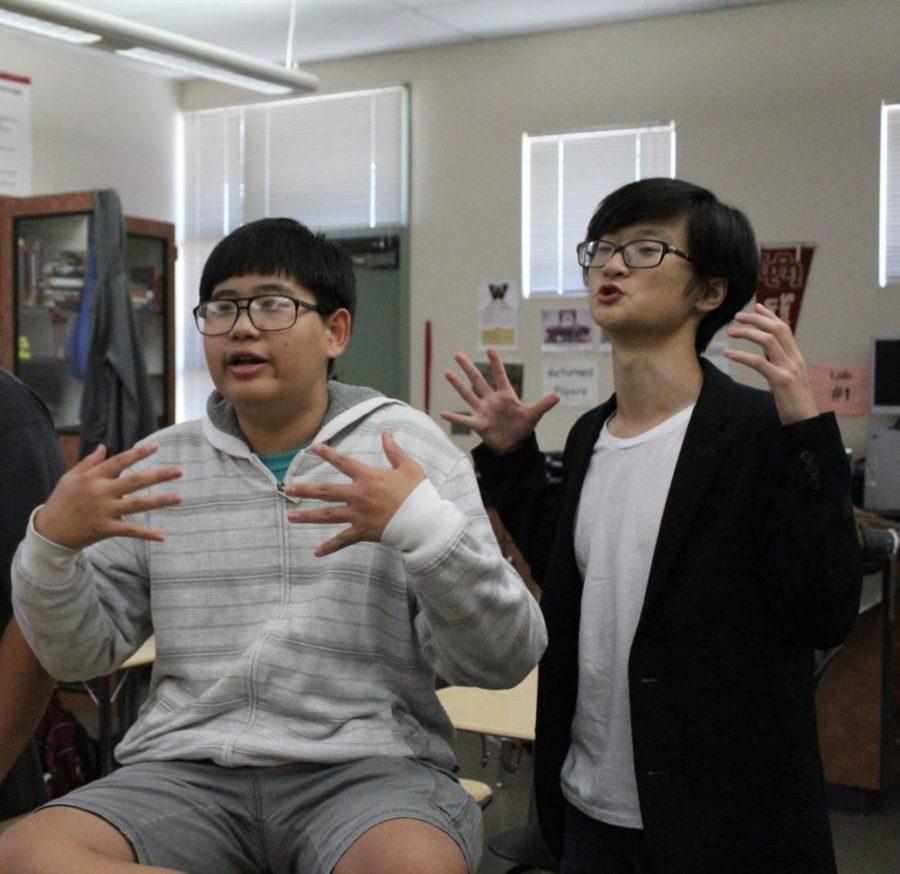 "As they play ""Killing Bill Nye"" Zae Chung and Chi Hin Kwok defend their reasoning. Photo by Marley Sky"