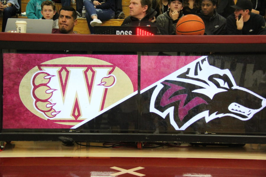 Men's varsity basketball team falls to Woodcreek in non-league match