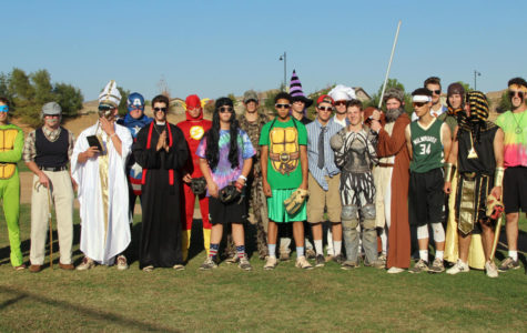 The baseball team dresses up in costumes to raise money for fallen officer