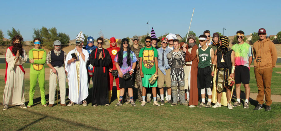 The baseball program pose to show off their costumes.