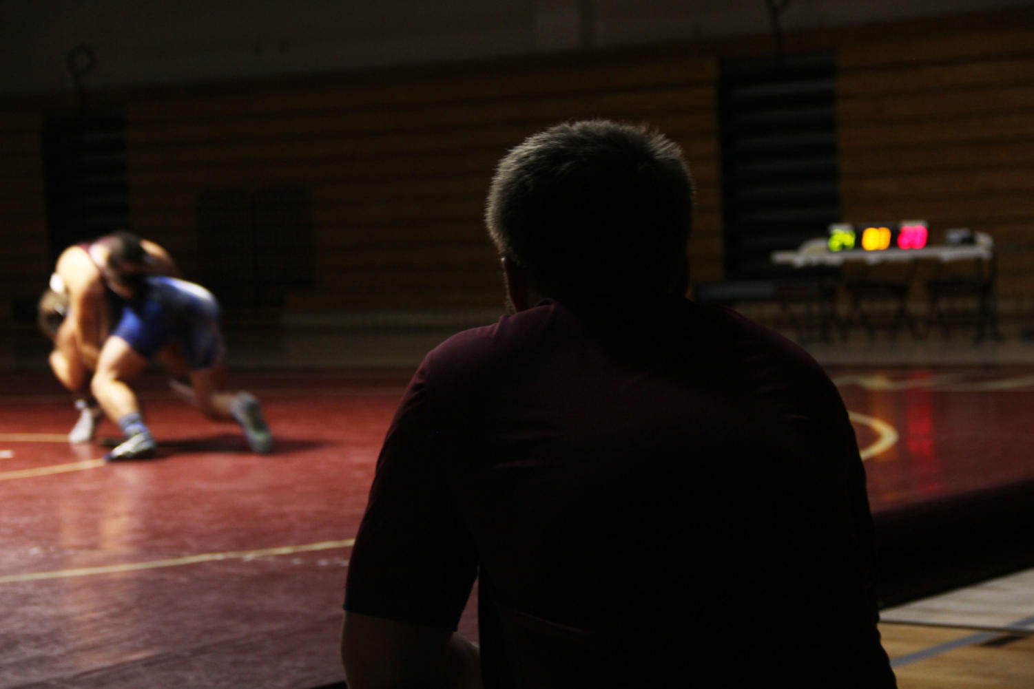 Coach Clarke Powers watches his team compete at the match against Rocklin Nov. 28.