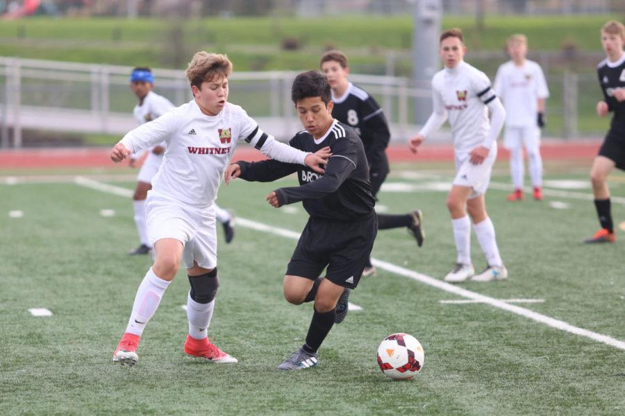 In the first half of the men's freshmen soccer game, Espen Sterri pressures a Bella Vista player.